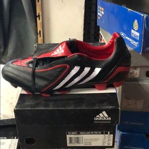 Black with red and white soccer shoes
